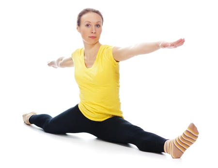 Young woman doing yoga exercise on a white background. Stock Photo - 19193959