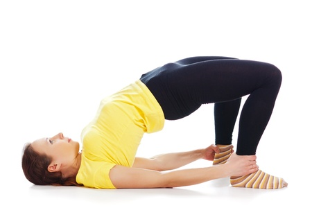 Young woman doing yoga exercise on a white background. Stock Photo - 19244837