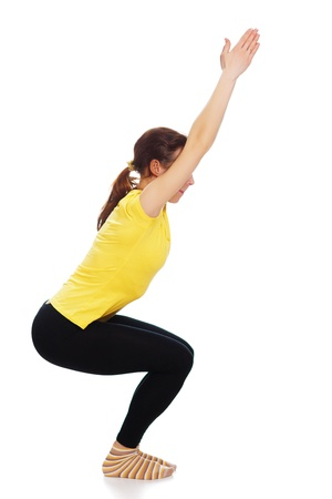 Young woman doing yoga exercise on a white background. Stock Photo - 19193946