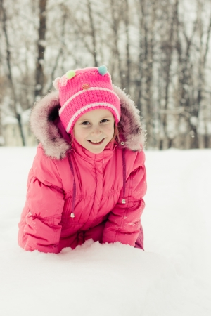 Beautiful happy girl in the red jacket winter outdoors. Stock Photo