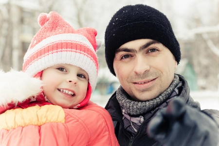 men with baby in winter photo