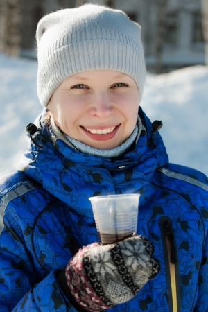 Woman holding hot drink outside in the winter  Stock Photo - 23737759
