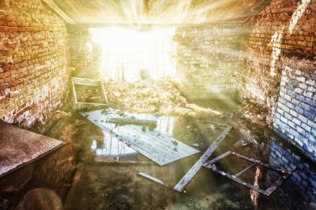 empty warehouse: The hole in the a wall breaks the sunlight.