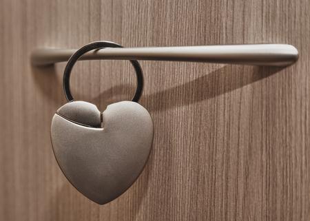 forbidden love: Castle in the form of heart on the door handle.
