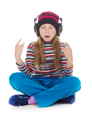 close your eyes: Girl with headphones listening to music on a white background.