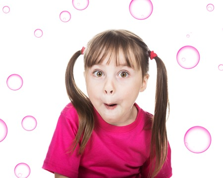 Surprised little girl in red on a white background.