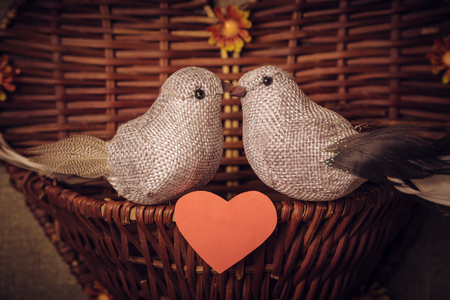 toy sack: The concept of Valentines Day two little bird the lovers, heart. Photos in retro style. Stock Photo