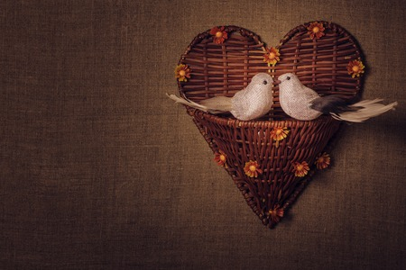 sacking: The concept of Valentines Day two little bird the lovers, heart. Photos in retro style. Stock Photo