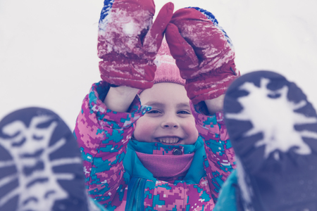 winter photos: Happy kid winter day playing in the snow. Photos in retro style.