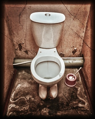 latrine: Old dirty public toilet. Photos in a grunge style.