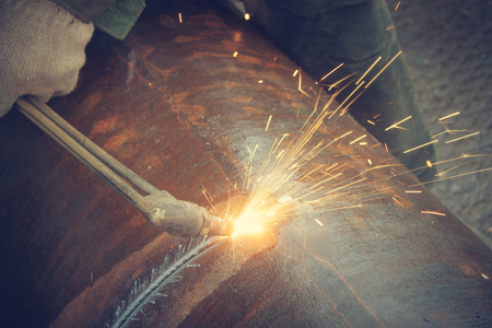 metal cutting: Metal cutting with acetylene torch.Staraya rusty pipe.
