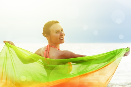 pareo: Girl in pareo relax by the sea. Stock Photo