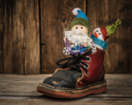 horse sleigh: Santa and snowman roll in an old shoe. Stock Photo
