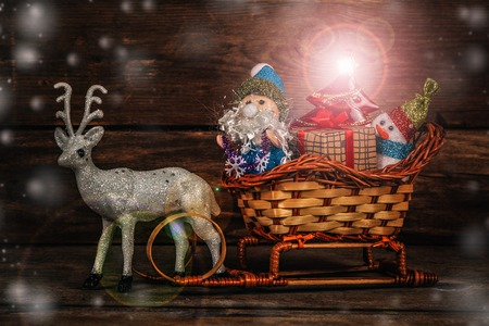 horse sleigh: Santa with a snowman and reindeer sledging.