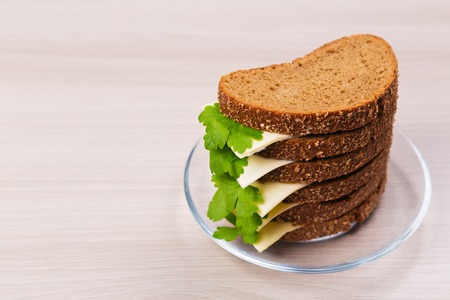 processed grains: Bread with cheese and parsley on the table.