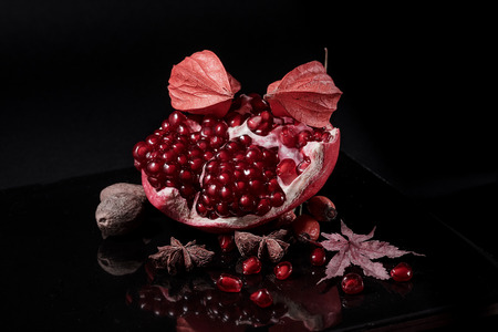 Perfect black and red composition with autumn fruits Stock Photo
