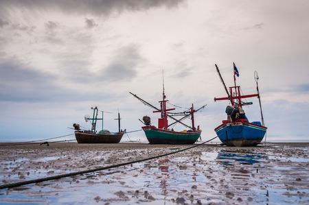 ebb: Fishing boats on beach at ebb tide, Hua Hin, Thailand