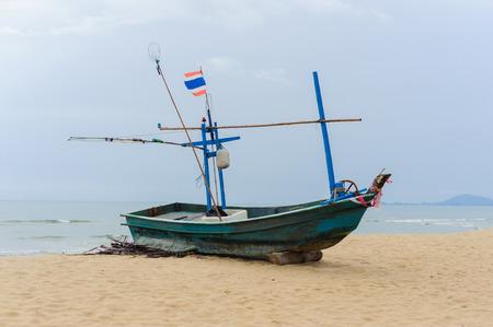 ebb: Fishing boat on a beach at ebb tide