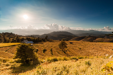 faintly visible: Dramatic sunset over a rice terraces of Papongpieng village, Chiang Mai, Thailand Stock Photo