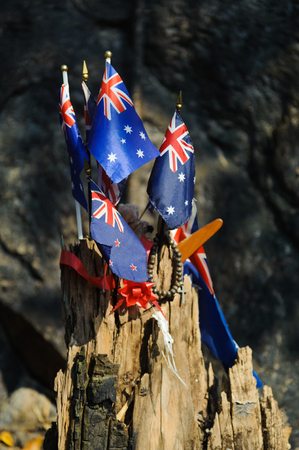 Peoples laid Australia flag, bead necklace and the boomerang to commemorate POWs at Hellfire Pass of Death Railway, Kanchanaburi, Thailand Stock Photo