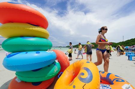 Larn Island, Pattaya, Thailand - September 12, 2012: Tourists enjoying on beautiful Tawaen beach at Larn Island near Pattaya, Thailand