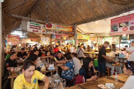 Bangkok, Thailand - Feb 11, 2018: Tourists enjoy shopping and eating Thai street food at Lad Mayom floating market.