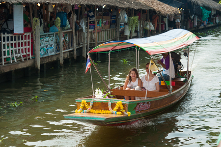 Bangkok, Thailand - Feb 11, 2018: Tourists enjoy traveling by tourist long-tail boat on Lad Mayom canal.