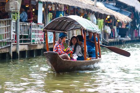 Bangkok, Thailand - Feb 11, 2018: Tourists enjoy traveling by tourist row boat on Lad Mayom canal.
