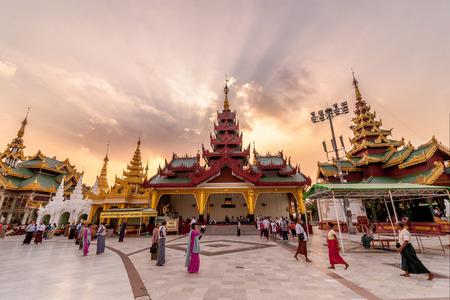 Yangon, Myanmar - Feb 13, 2018: Myanmar peoples and tourists walking around The Shwedagon Pagoda, the most sacred pagoda of Myanmar, in the evening. Editorial