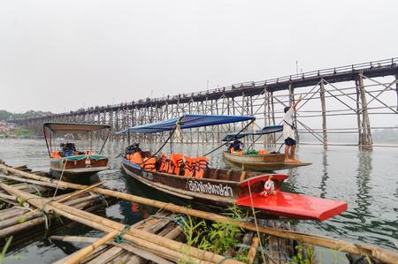 Kanchanaburi, Thailand - December 30, 2015: Long tail boat waiting for tourist near Mon bridge, Sangklaburi Editorial