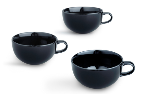 Empty black coffee cups in different angle of view isolated on white Standard-Bild