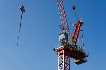 Construction crane on a blue sky background