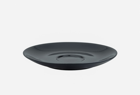 Empty black porcelain plate isolated on white background.