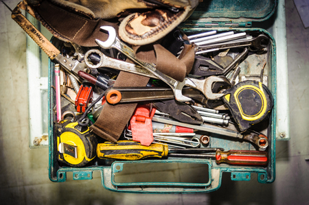Dirty set of hand tools in tool box