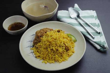 Biryani is a South Asian mixed rice dish. Muslim yellow rice with chicken Standard-Bild