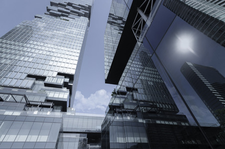 Modern skyscrapers decorated with mirrors  in perspective from below.