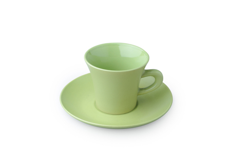 Green coffee cup isolated on white. Porcelain glass Standard-Bild