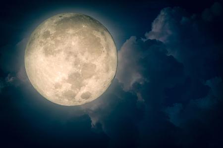 Surreal fantasy full moon on cloudy night sky Standard-Bild
