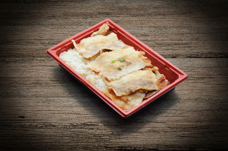 Roasted pork topping on japanese rice in plastic tray. Frozen meal. Microwave food Standard-Bild