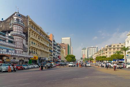 Yangon, Myanmar - Feb 13, 2018: People crossing on the busy street of downtown Yangon