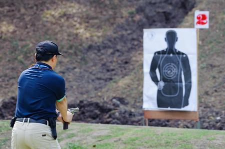 Man holding handgun and preparing to shoot the target
