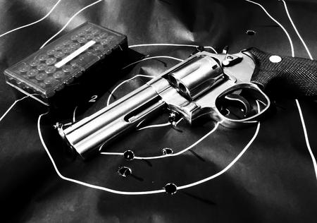 .357 Magnum revolver handgun, ammunition and human silhouette shooting target