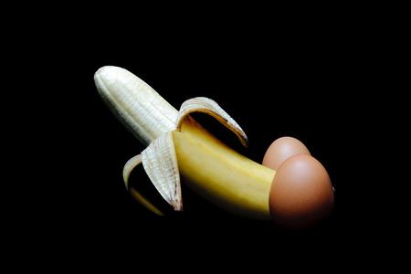Banana peel and eggs look alike penis. Funny concept. Studio shot