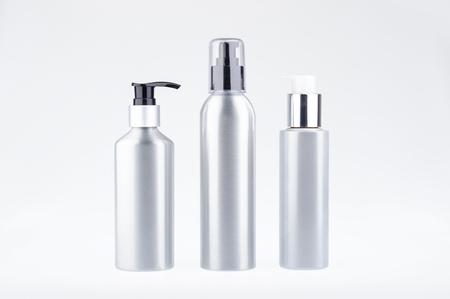 Aluminium cosmetic dispenser bottles. Cosmetic product dispenser bottle Standard-Bild
