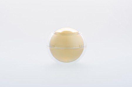 Spherical cream jar. Ball shape cosmetic container isolated on background. Studio shot