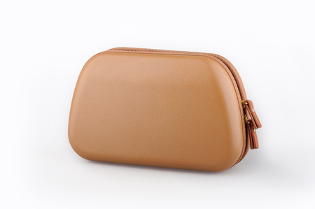 Brown cosmetic bag. Business Class amenity kit isolated on background