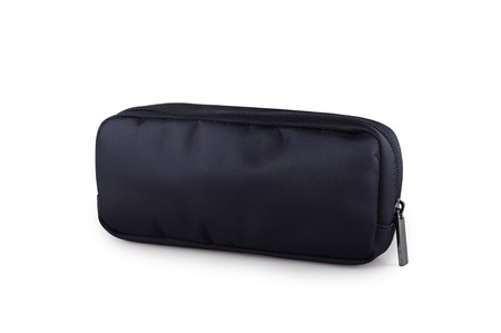 Black fabric cosmetic bag. Business Class amenity kit isolated on background