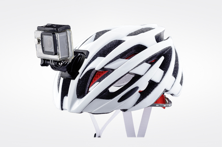 Bicycle helmet with front action camera isolated on white background Reklamní fotografie