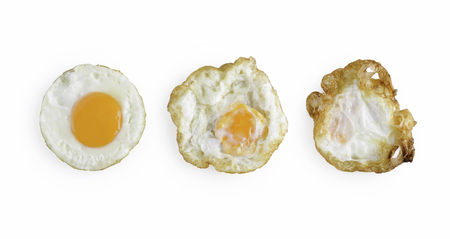 Three levels of fried eggs isolated on white background. Top view of fried eggs Standard-Bild