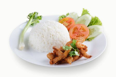 Authentic Thai fried pork with garlic on rice isolated on white background